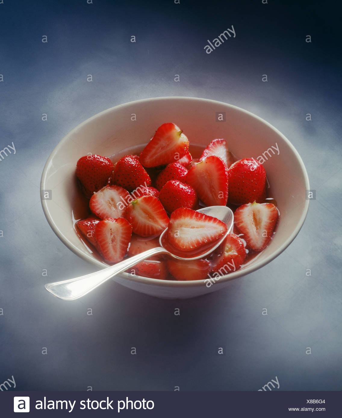 bowl of strawberries in sirup - Stock Image
