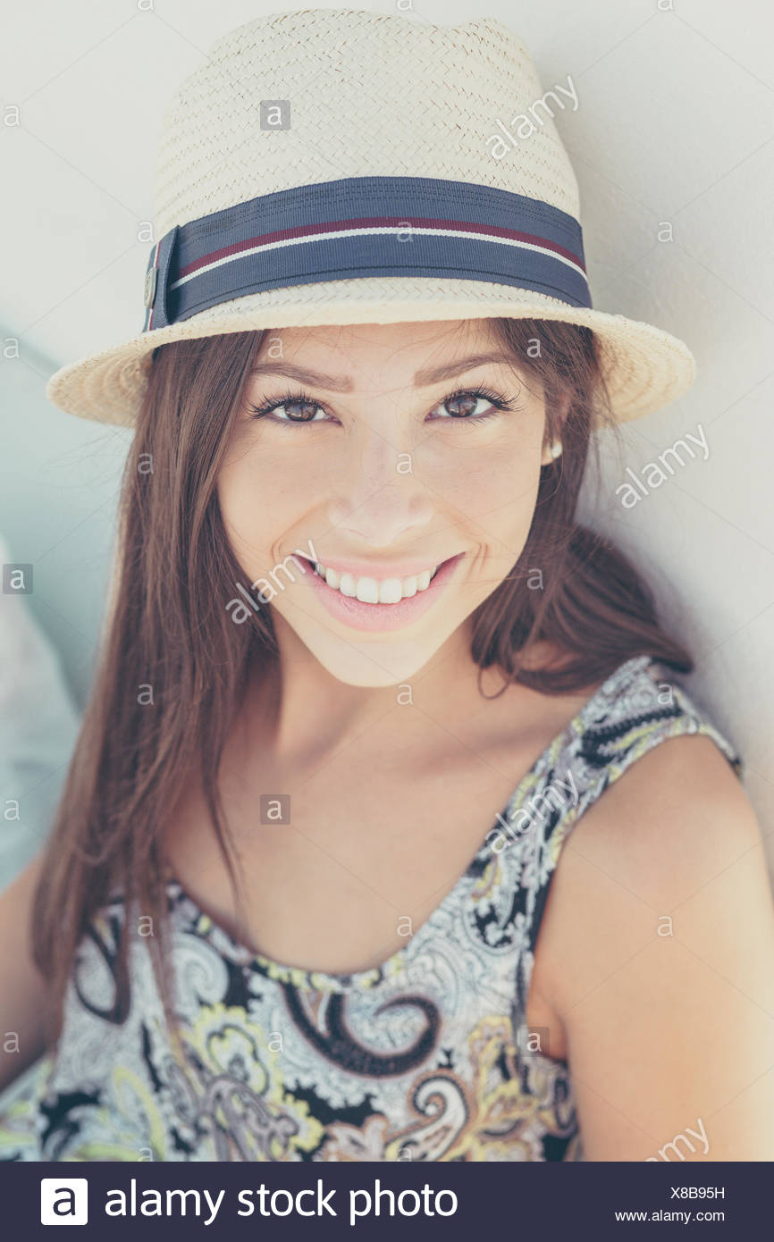 Portrait of young woman with sun hat - Stock Image