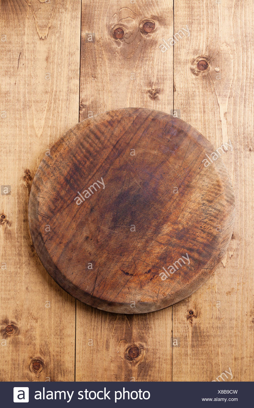 Kitchen Cutting board on wooden texture background - Stock Image