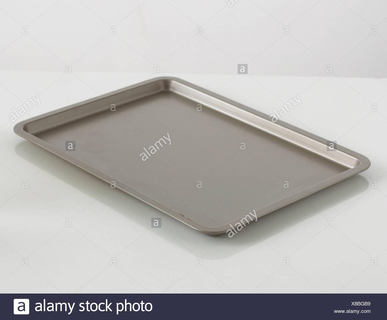 Baking tray on white background - Stock Image