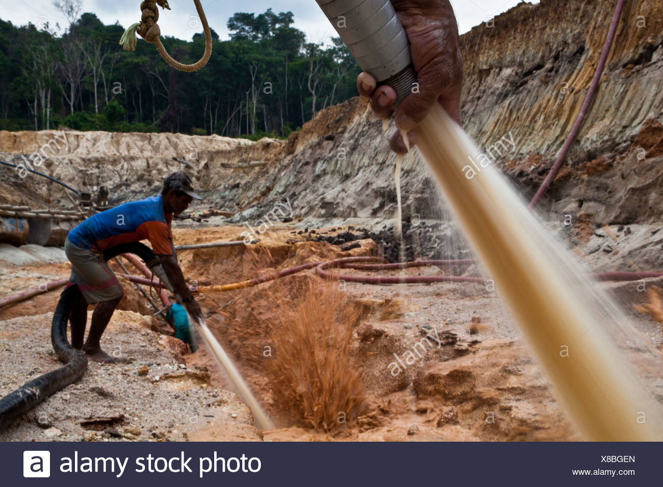 Gold mining Amazon rain forest Hydraulic mining known as chupadeira high-pressure jets of water to dislodge rock material - Stock Image