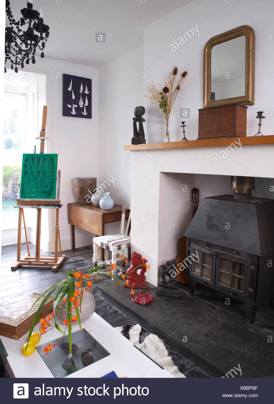 Wood Burning Stove In Coastal Cottage Living Room Stock