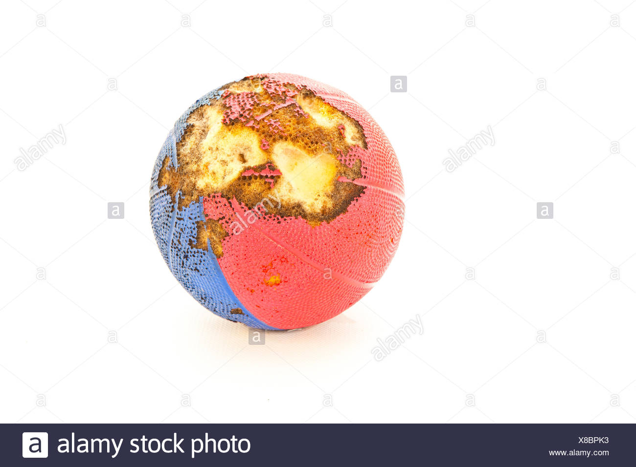 A foam ball which has been damaged by rodents - Stock Image