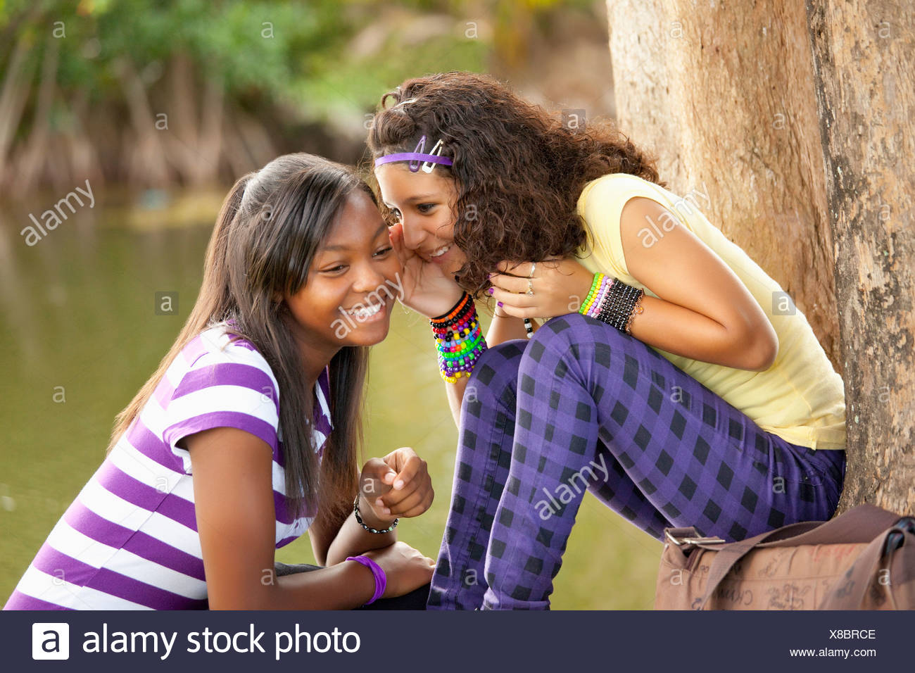 Fort Lauderdale, Florida, United States Of America; Two Teenage Girls Telling Secrets - Stock Image