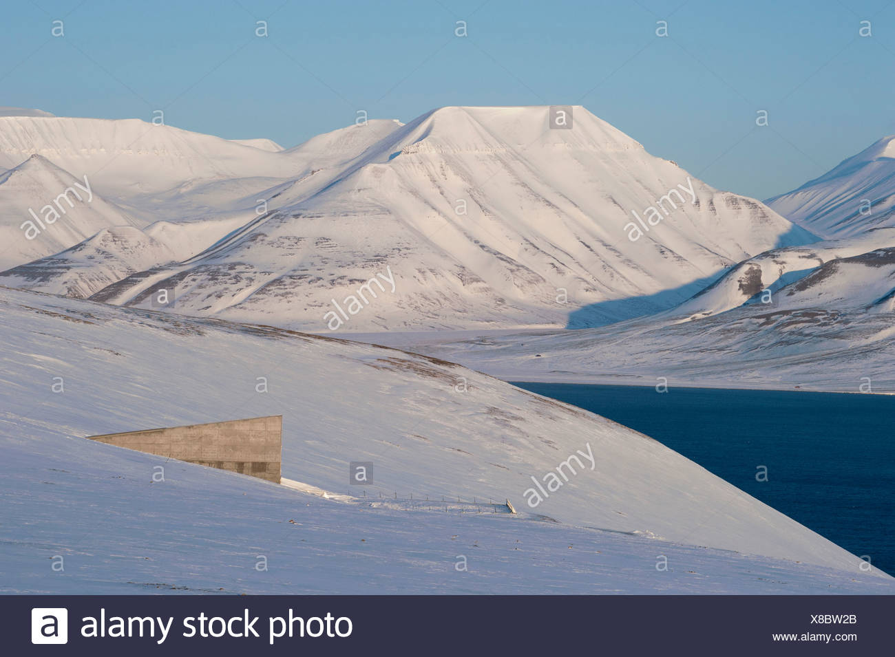 The entrance to the 'Svalbard Global Seed Vault', Adventfjorden, Advent Bay at back, Longyearbyen, Spitsbergen, Svalbard, Norway - Stock Image