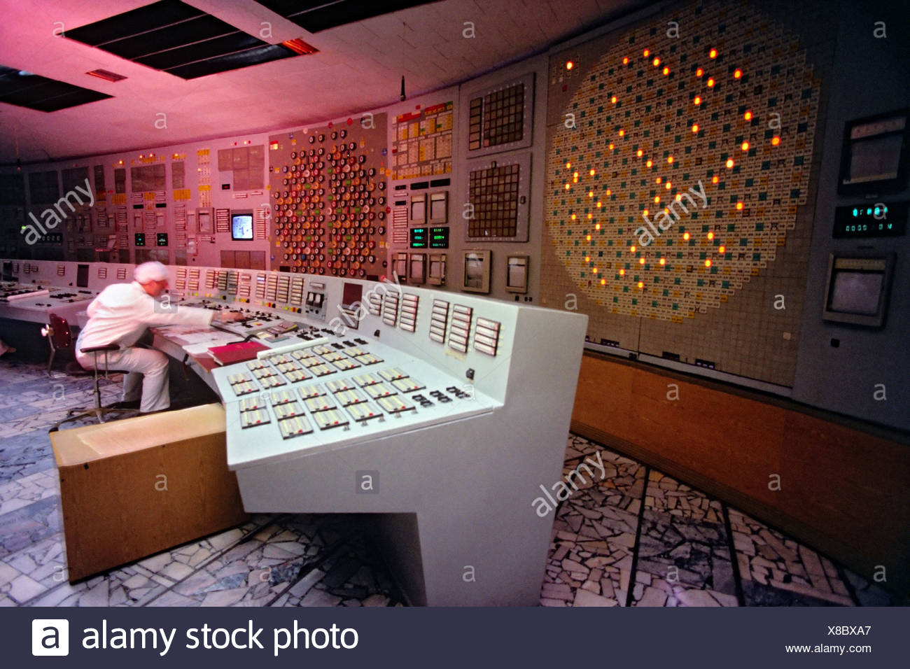 A technician monitors nuclear power production in one undamaged reactors Chernobyl nuclear power complex. One reactors suffered Stock Photo