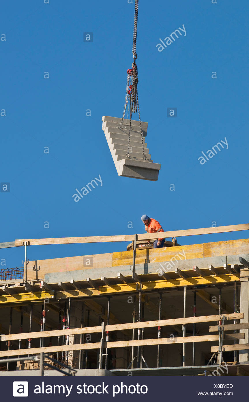 Construction site, prefabricated stairs are lifted to the installation site by crane, Bonn, North Rhine-Westphalia, PublicGround - Stock Image
