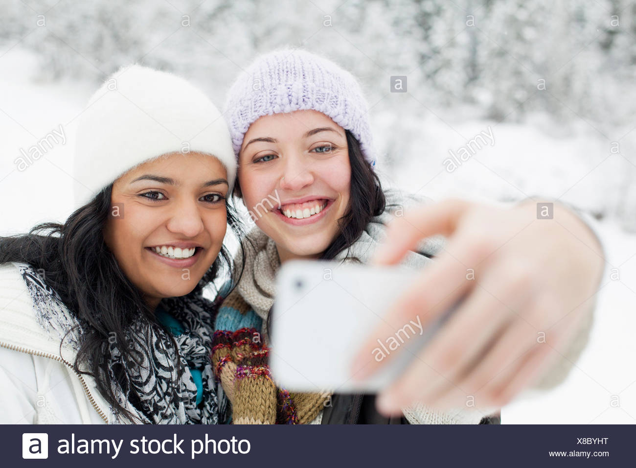 self-portraits in the snowy countryside - Stock Image
