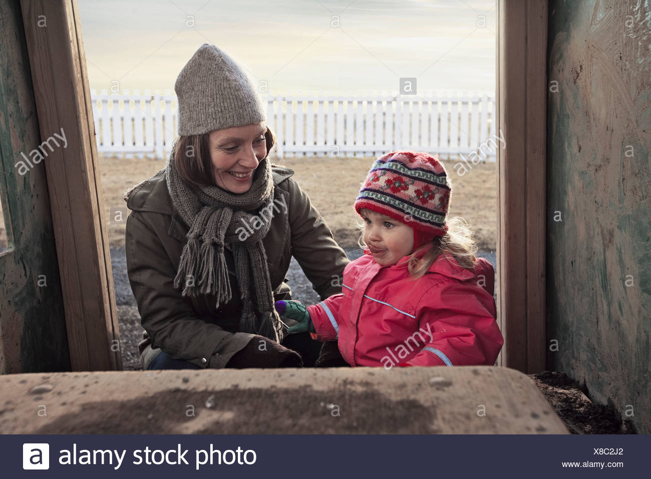 Mother and daughter playing outdoors Stock Photo
