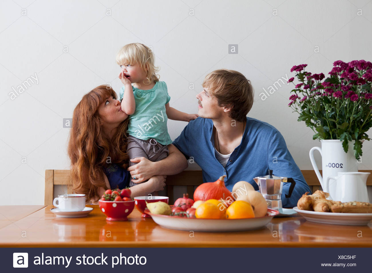 A young family having breakfast - Stock Image