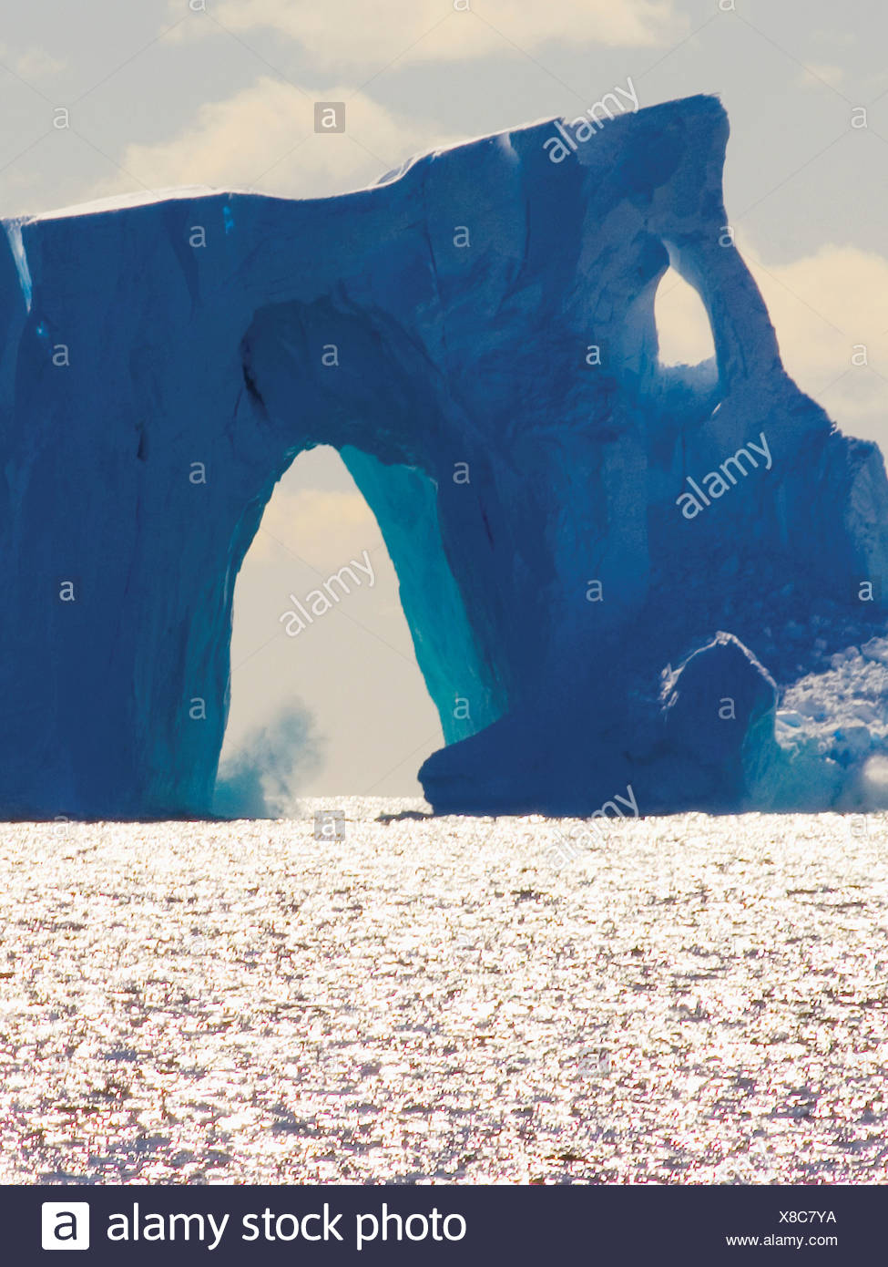 Arches Formed in an Immense Tabular Iceberg - Stock Image