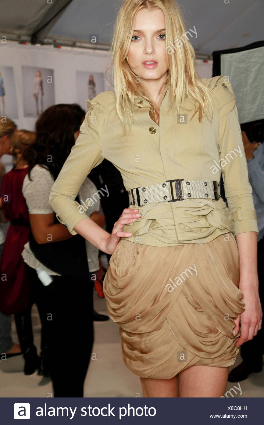 0bb610aee51e Burberry Prorsum Backstage London Ready to Wear Spring Summer Model Lily  Donaldson wearing a beige gathered and draped detail