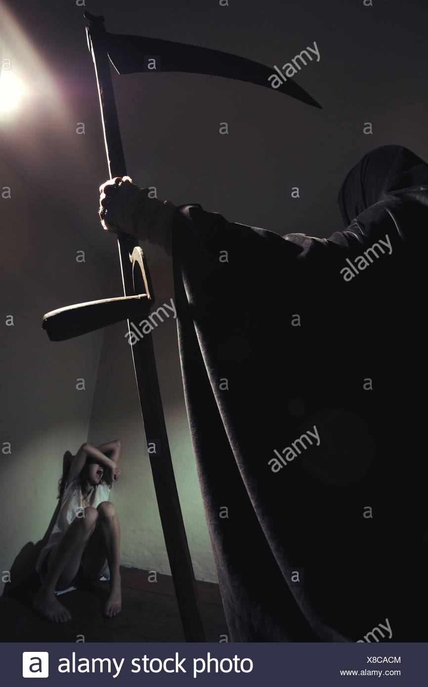 Grim reaper menace a young woman scared - Stock Image