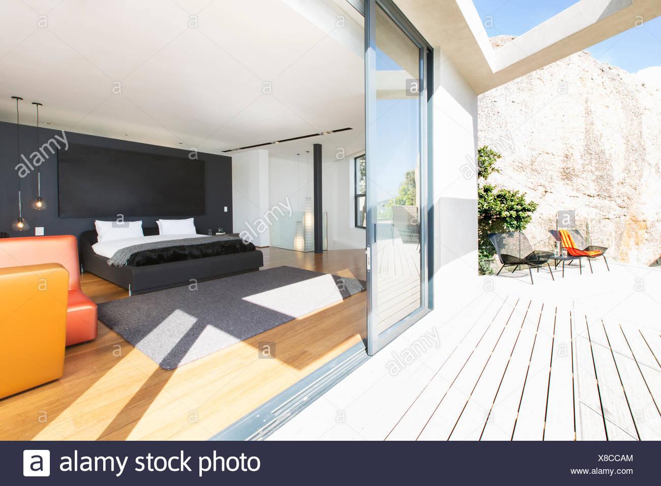 Sliding Glass Door Onto Bedroom In Modern House Stock Photo