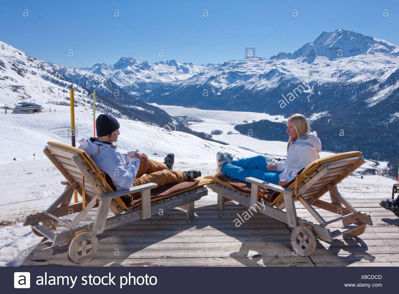 Couple, deck chair, restaurant, Trutz, view, Engadin, Engadine, winter sports, canton, GR, Graubünden, Grisons, Oberengadin, win - Stock Image