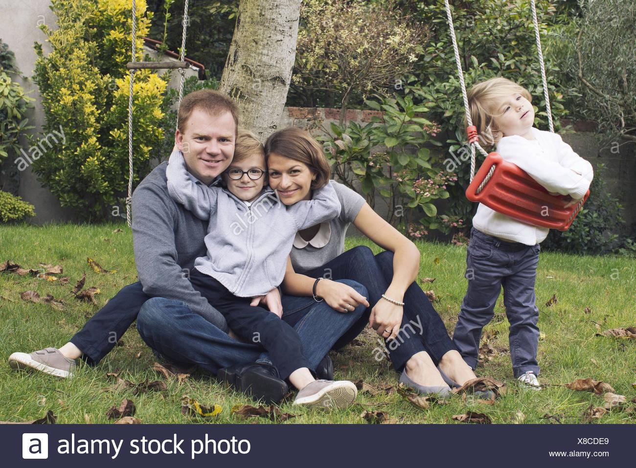 Familiy in park, portrait - Stock Image