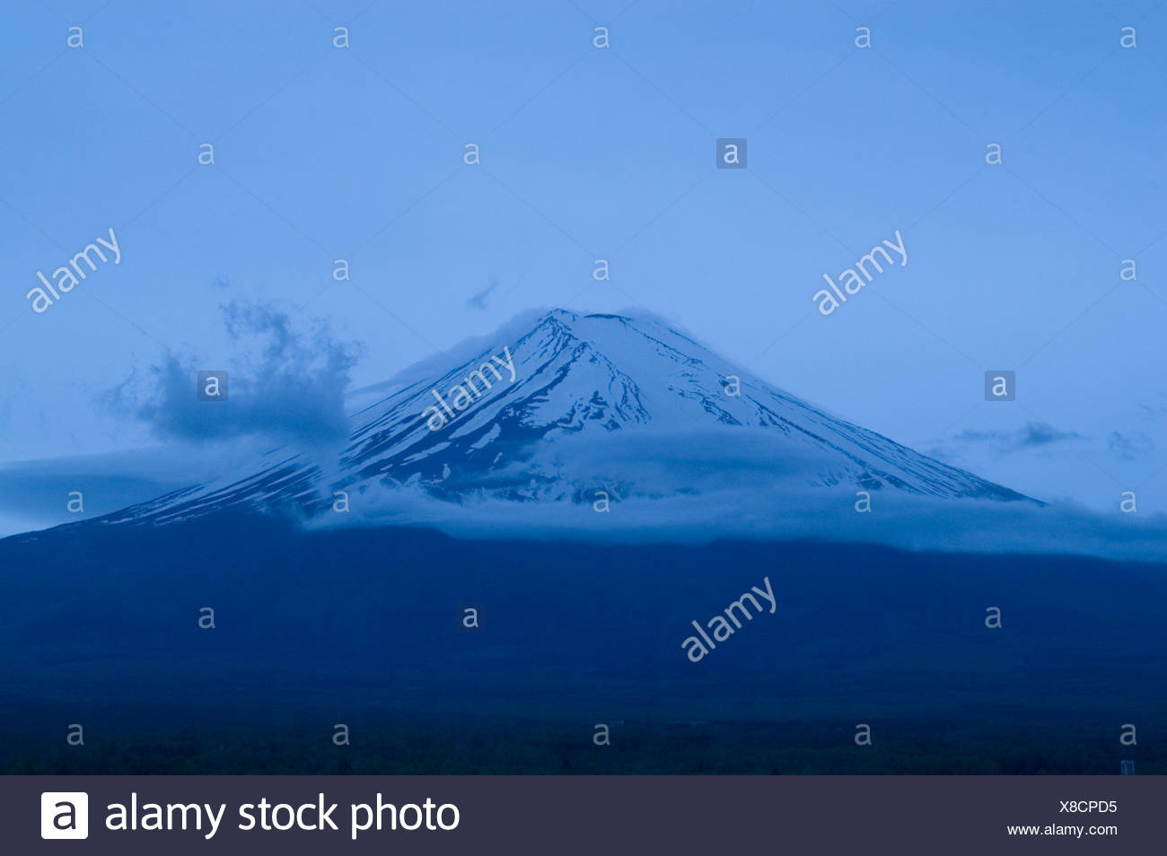 Mount Fuji, the highest peak in Japan, just after sunset. - Stock Image