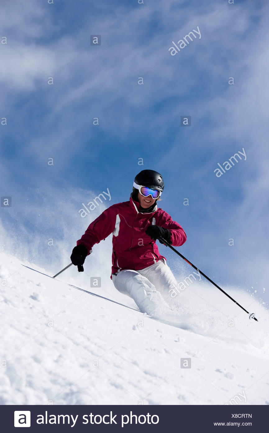 Woman in red & white outfit turning. - Stock Image