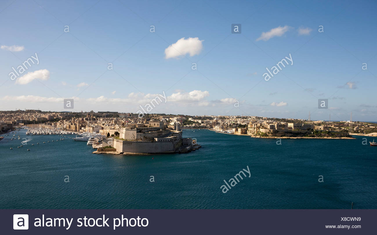 View from Valletta of Grand Harbour, from left: Rinella, Kalkara, Fort St Angelo and the yacht harbour, Valletta, Malta, Europe - Stock Image