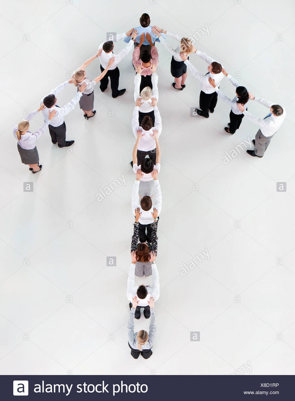 Business people forming arrow - Stock Image