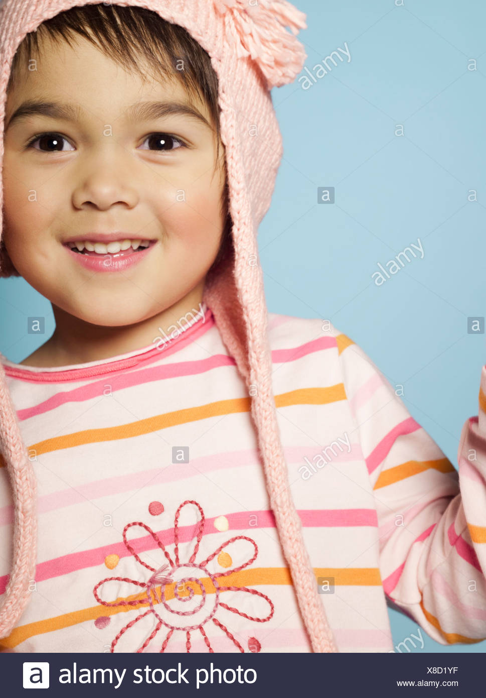 Portrait of little girl with wool hat - Stock Image