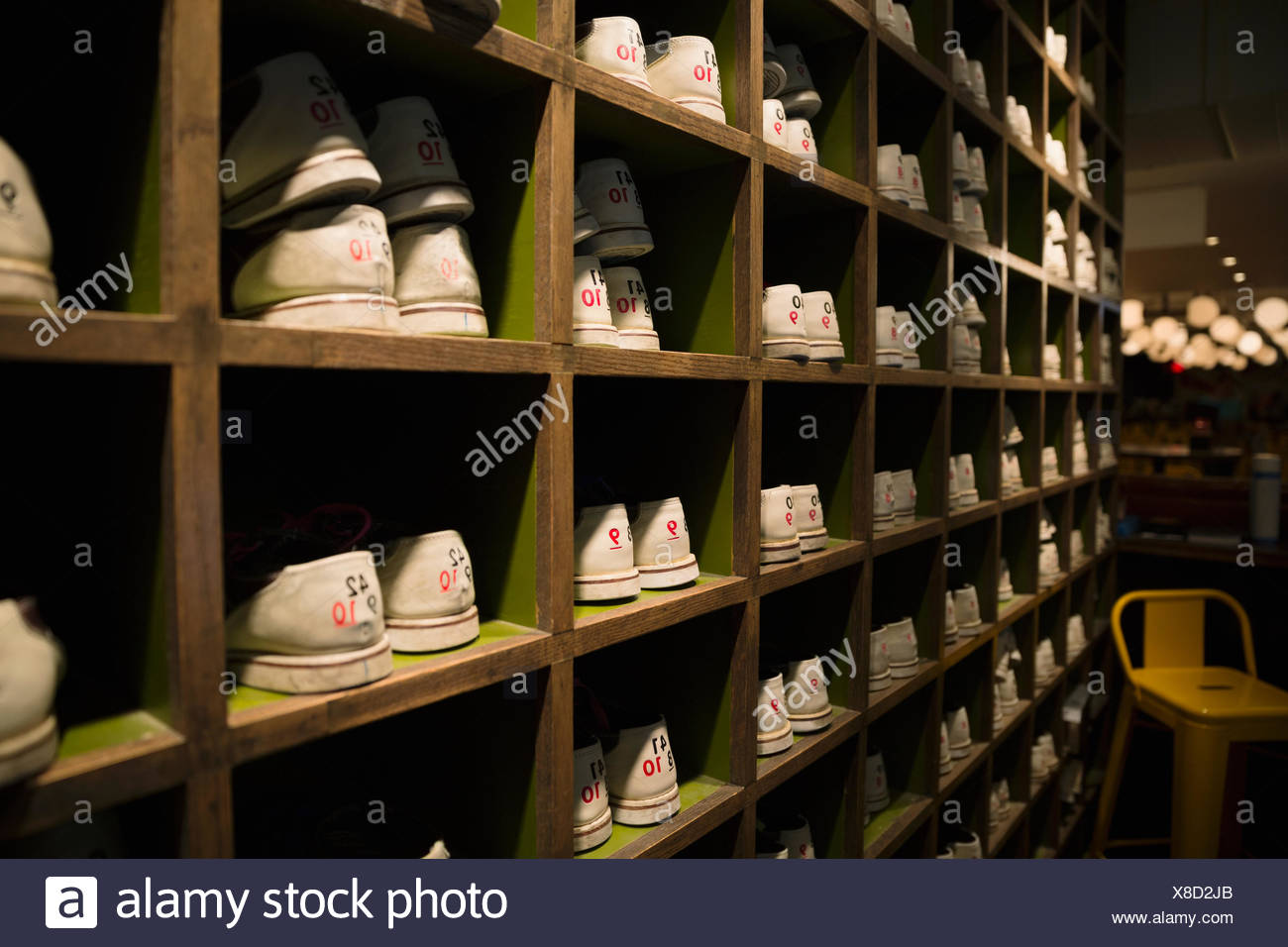bowling shoes organized in cubby shelves bowling alley - Stock Image