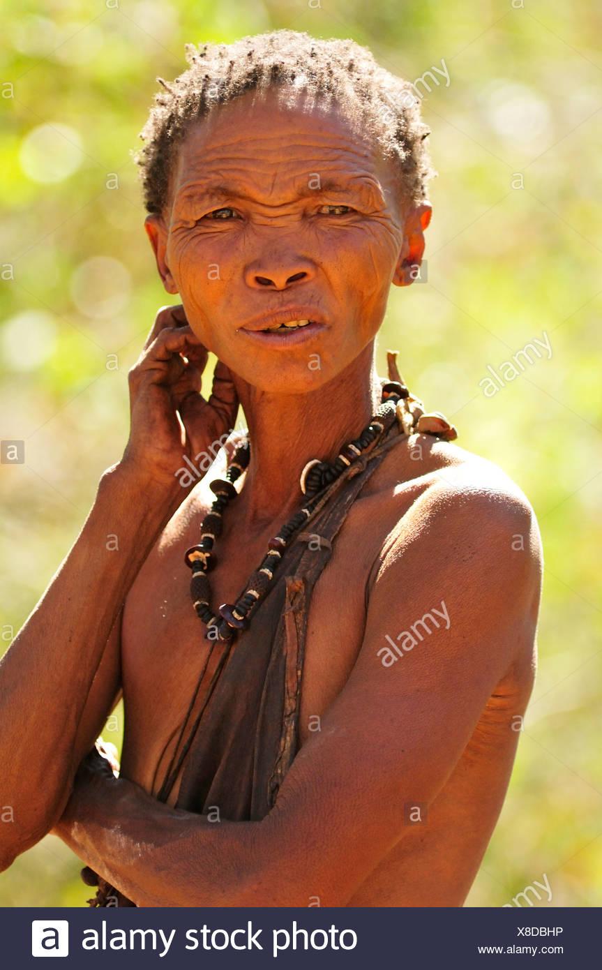 Africa, Bushmen, Namibia, Portrait, african, clan, confused, hunter, gatherer, natural, necklace, nomad, old, primitive, speakin - Stock Image