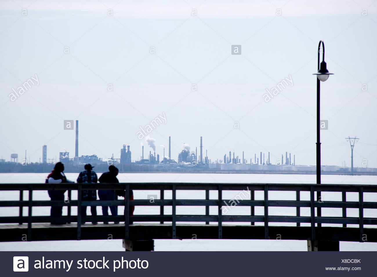 Dealware Bay scenic view darkened by industrial plants. - Stock Image