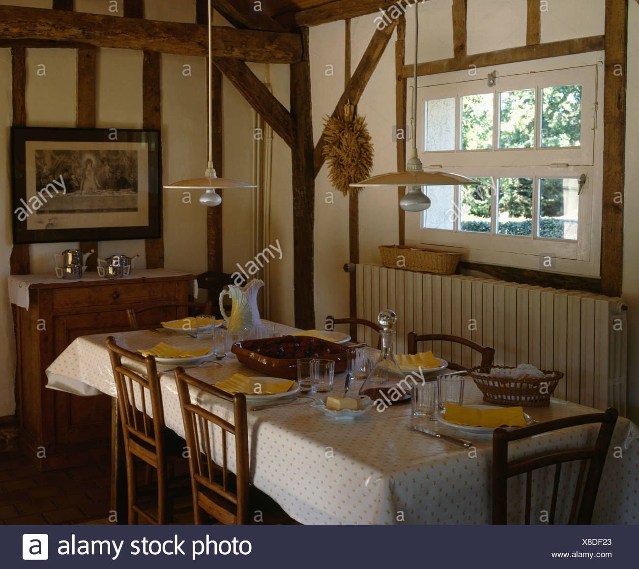Double Pendant Lights Over Table In Country Diningroom With Beamed Walls Stock Photo Alamy