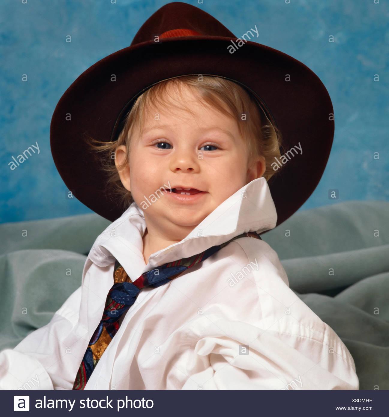 febdf350bdd4 Baby Boy In Huge Shirt Stock Photos   Baby Boy In Huge Shirt Stock ...