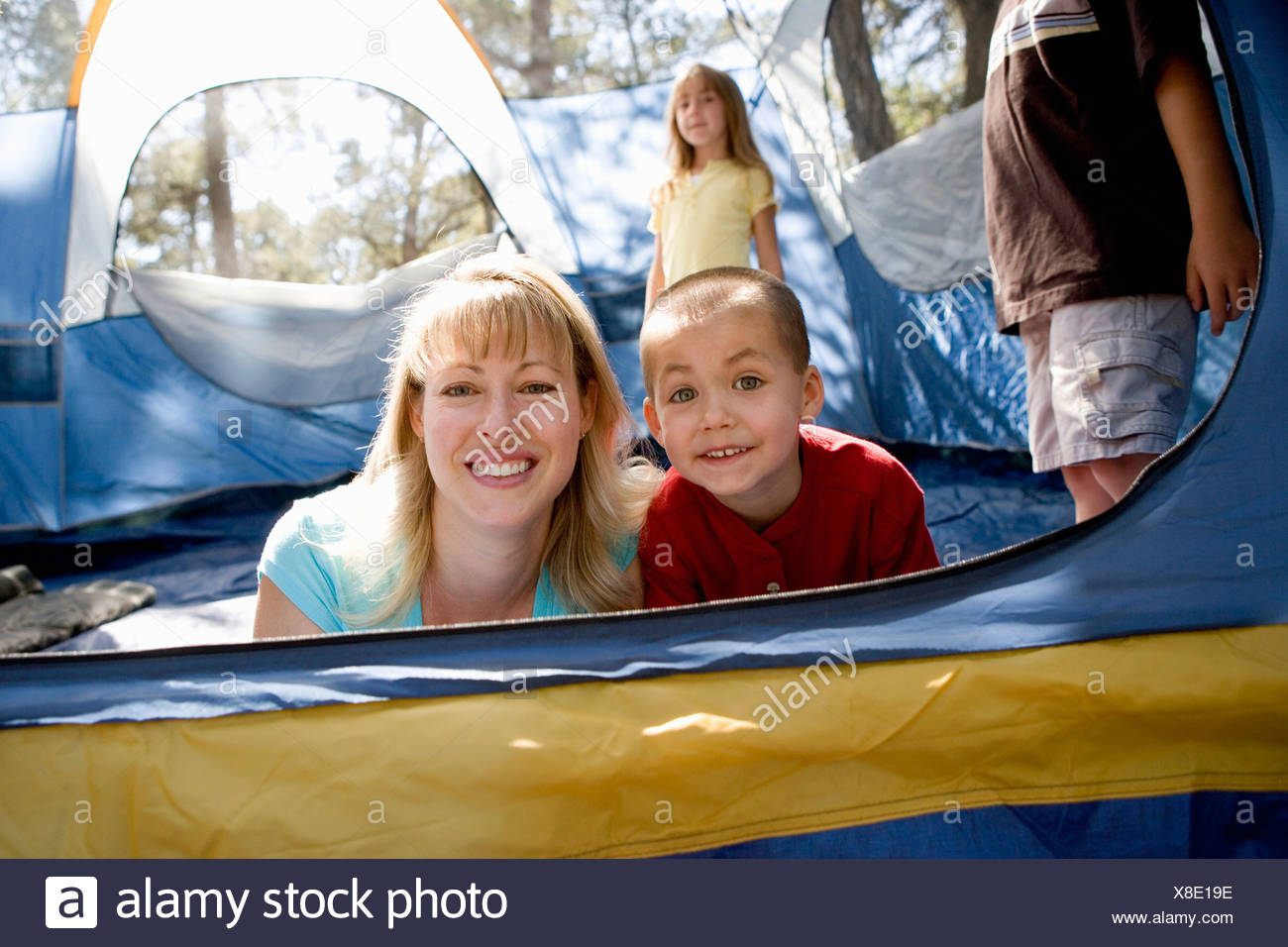 Portrait of a mother and son in a tent - Stock Image