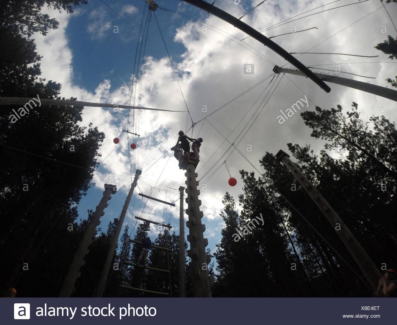 People Slick Lining In Slacklining Park - Stock Image