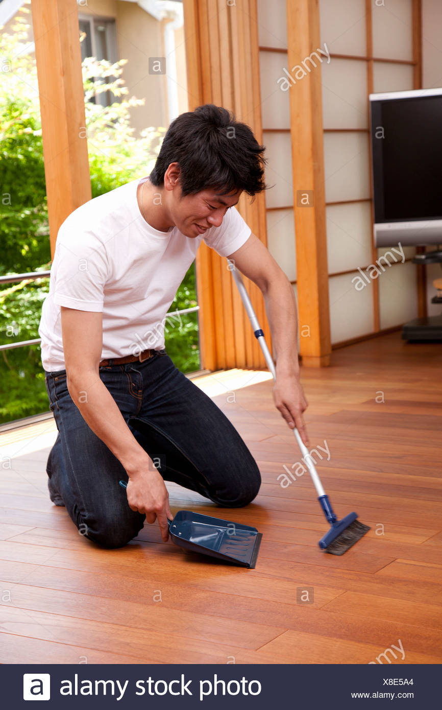 mid adult man sweeping floor with broom and dustpan stock photo alamy https www alamy com mid adult man sweeping floor with broom and dustpan image280594668 html