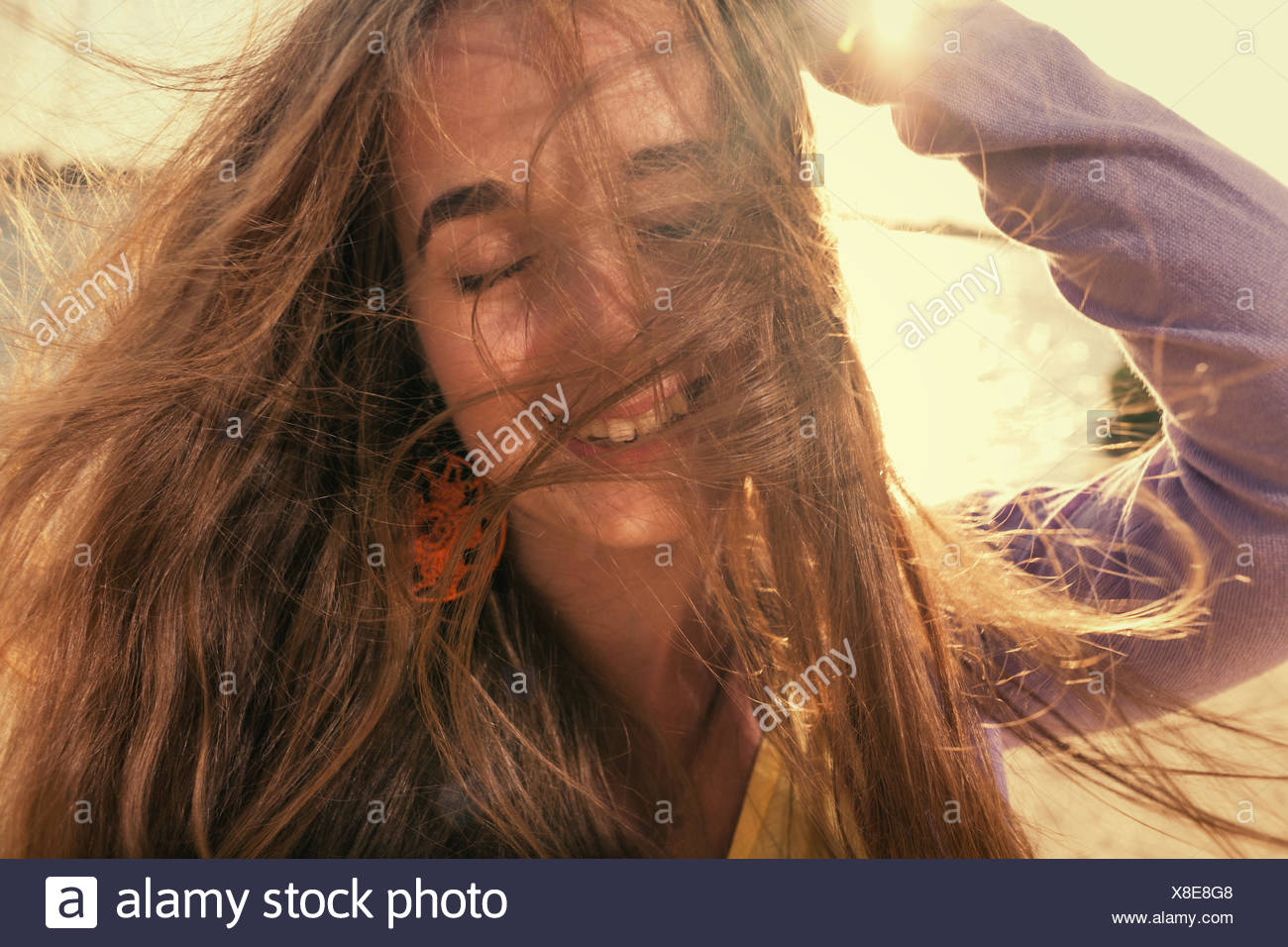 Long haired blonde outdoors wind - Stock Image