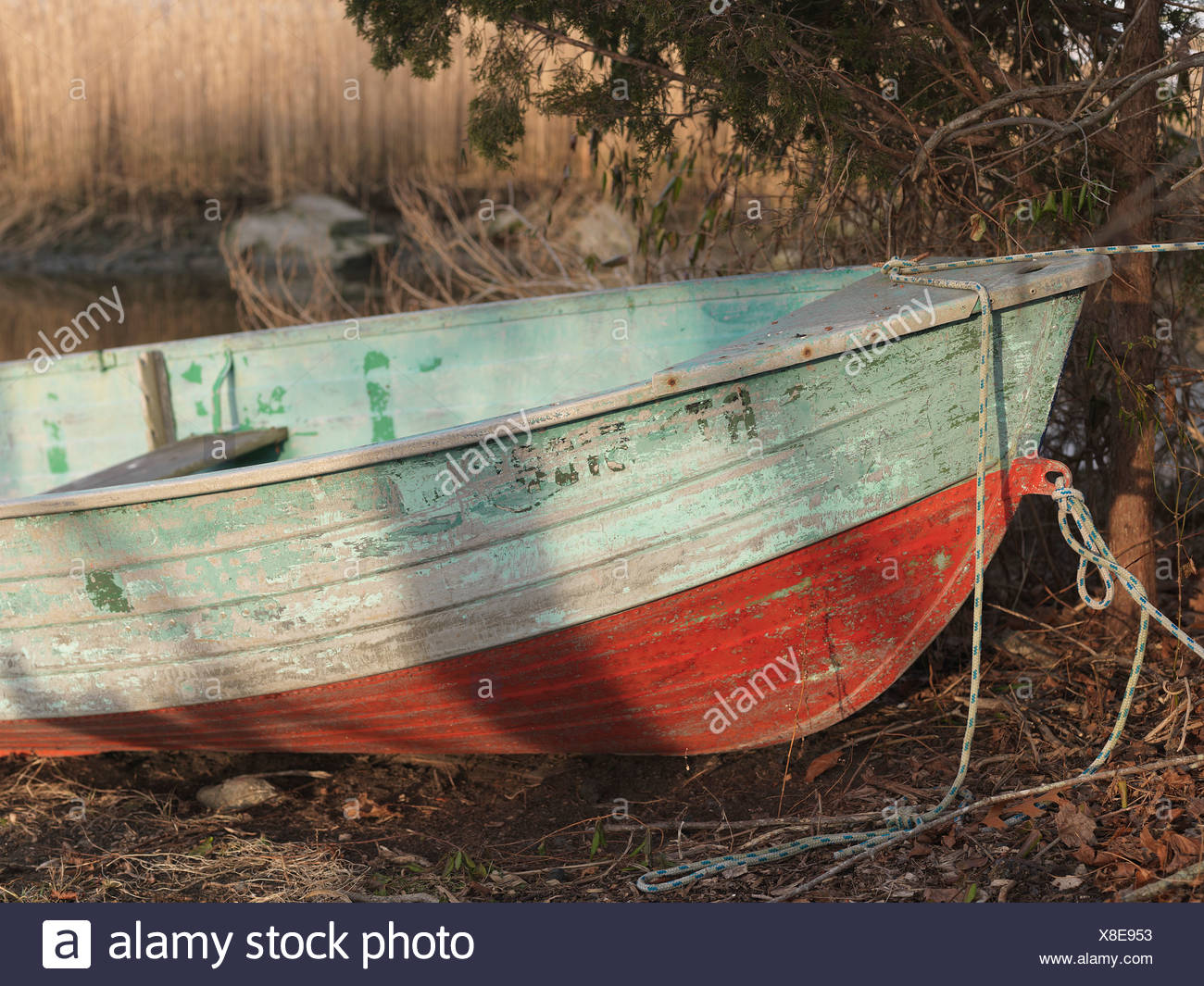 old, patina, flaking, paint, green, blue, red, rivets, boat, rowing, aluminum, edge, rear, rope, knot, rust, age, color, edge, - Stock Image