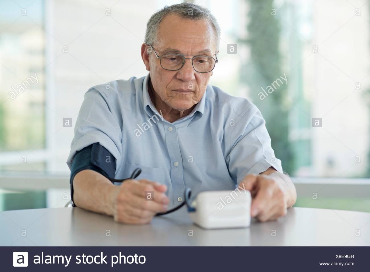 Senior man taking his own blood pressure. Stock Photo