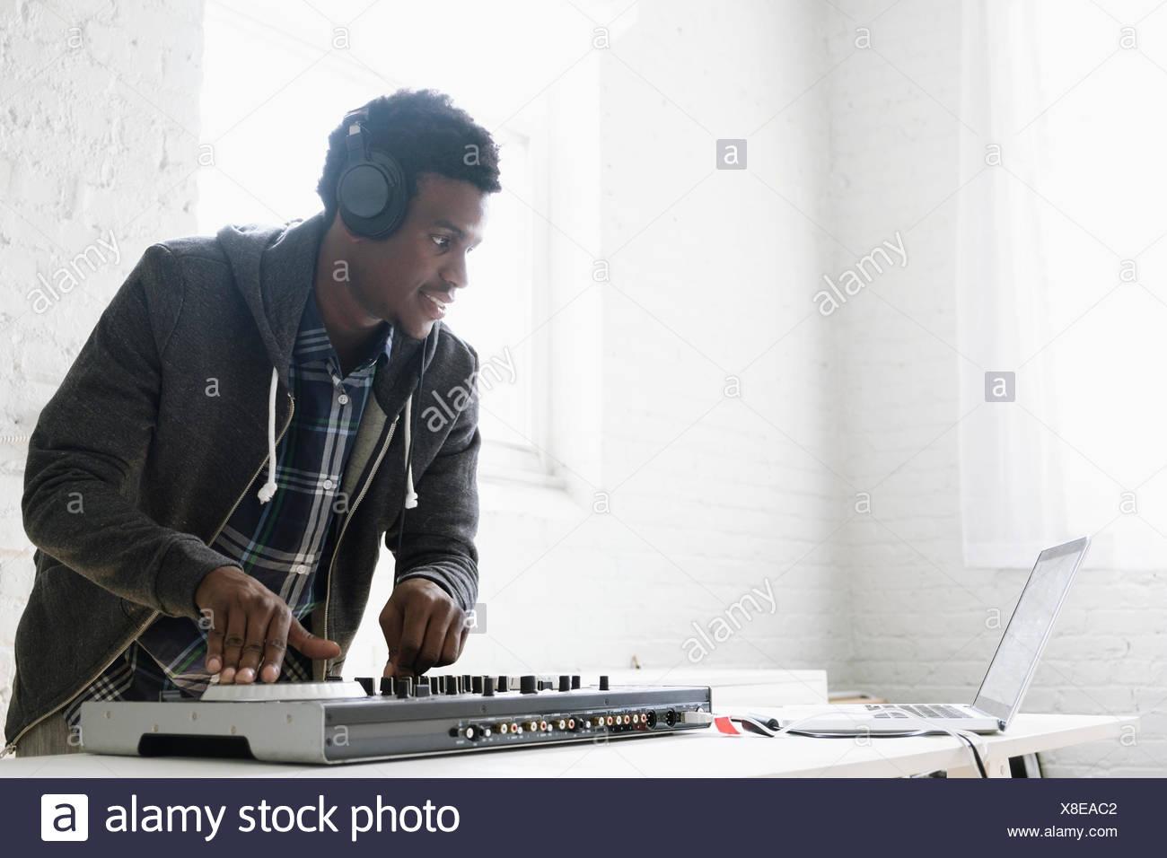 DJ using mixing desk Stock Photo