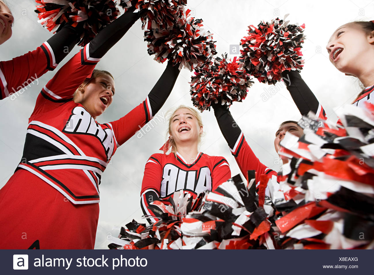 Cheerleaders with pom poms - Stock Image
