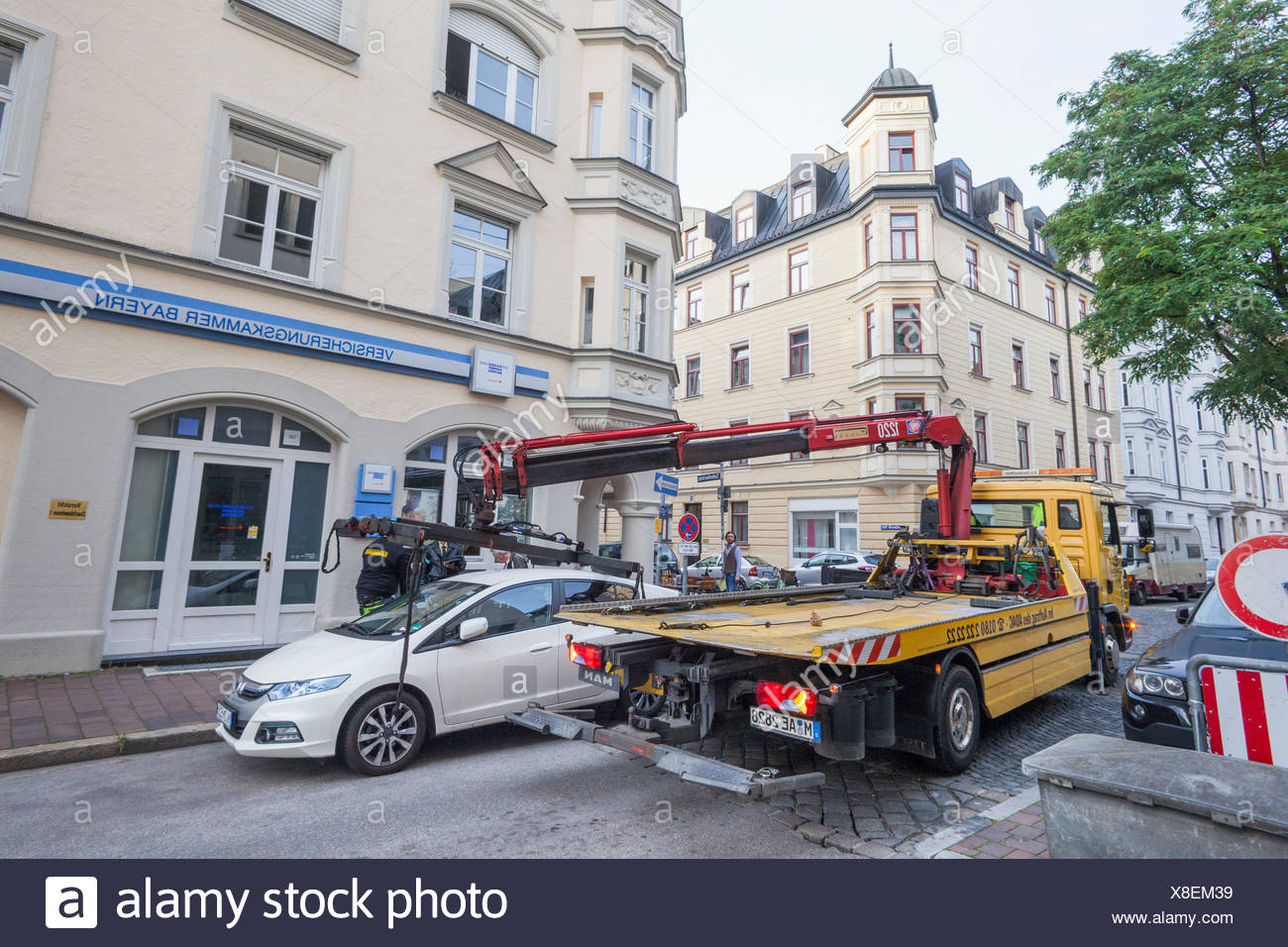 Germany, Bavaria, Munich, Illegally Parked Car being Removed - Stock Image