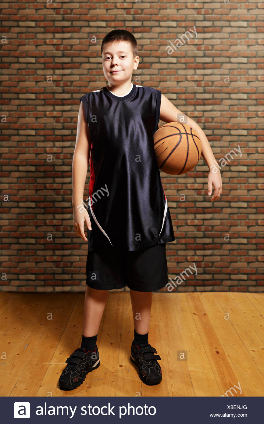 Contented kid with basketball - Stock Image