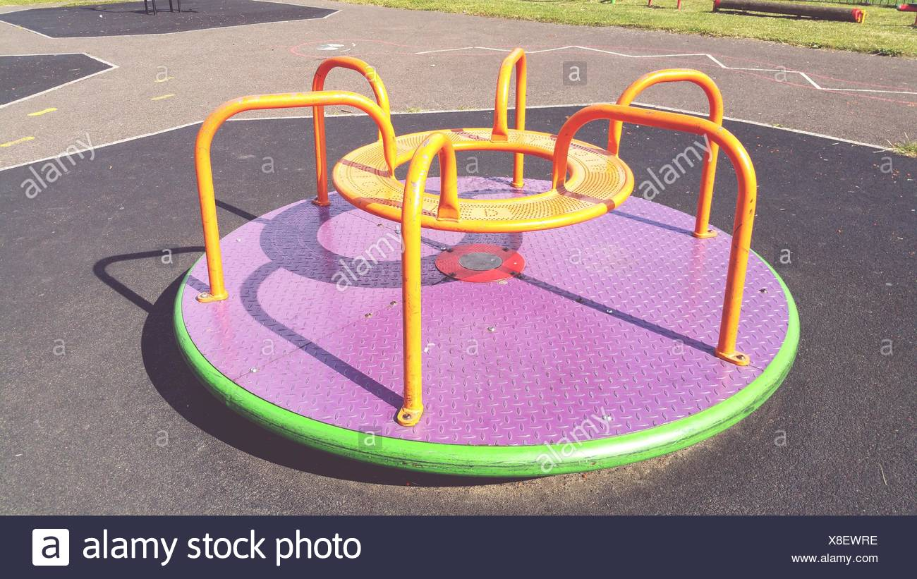 High Angle View Of Merry-Go-Round In Playground - Stock Image