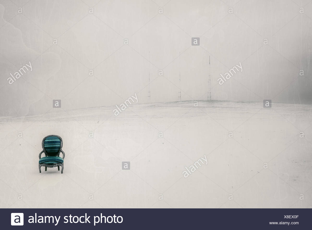 USA, Iowa, Cedar Rapids, Blue and green chair in white landscape - Stock Image