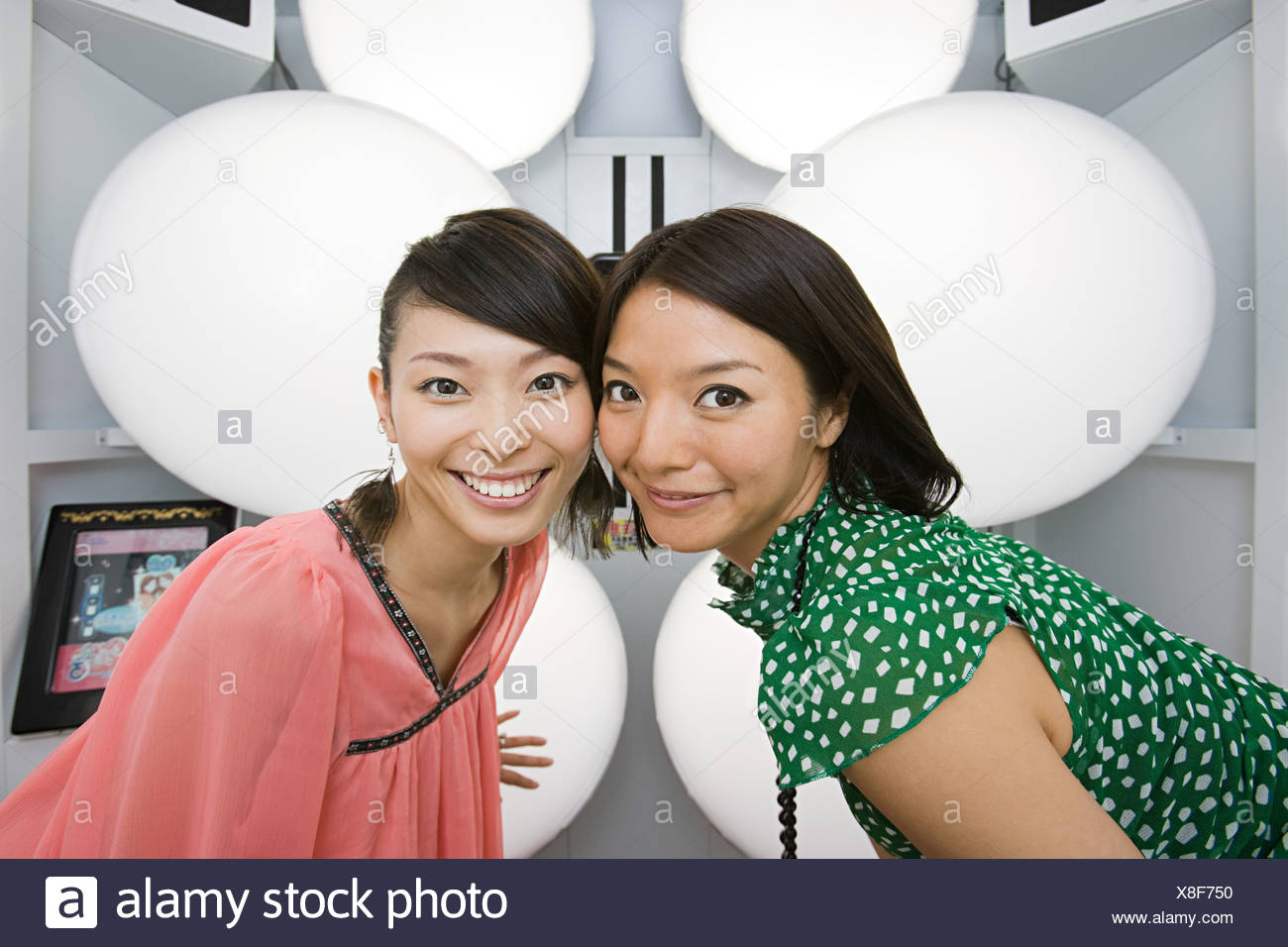 Friends in a photo booth - Stock Image