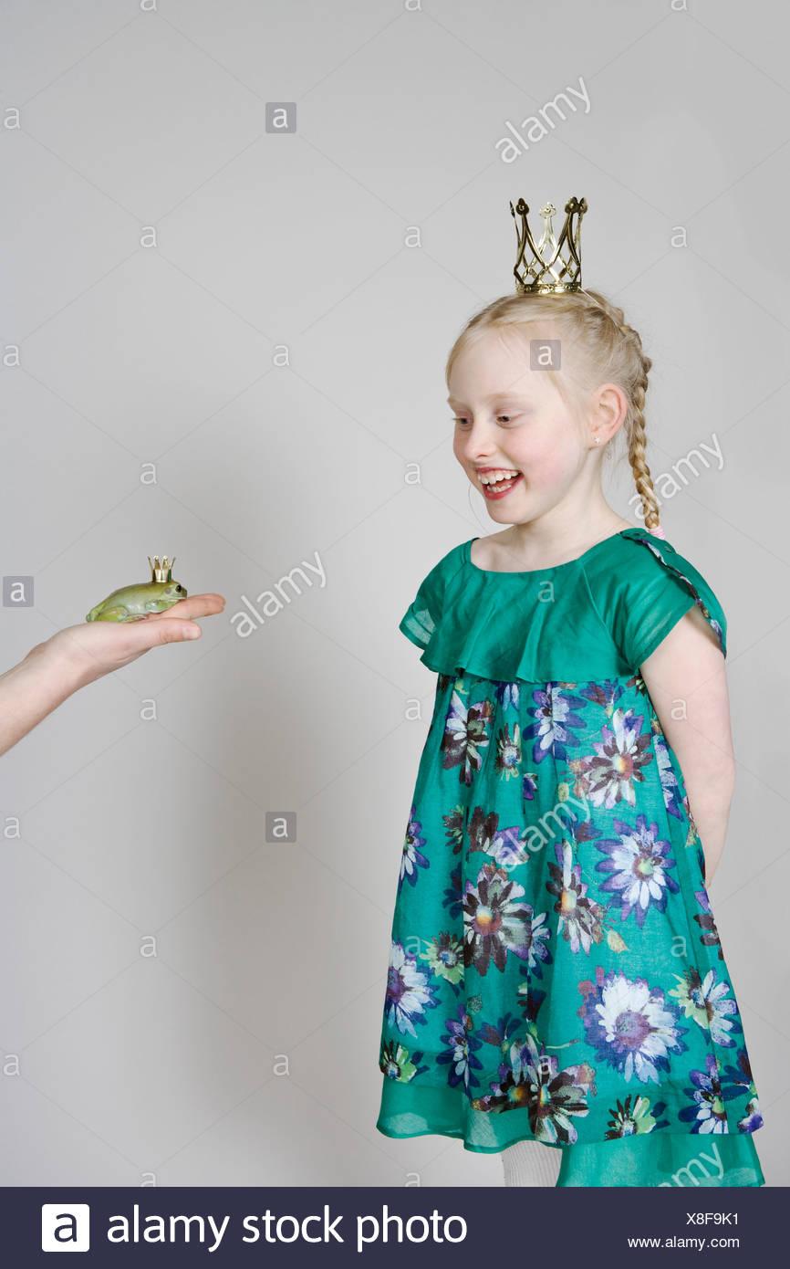 A girl princess and a frog prince - Stock Image