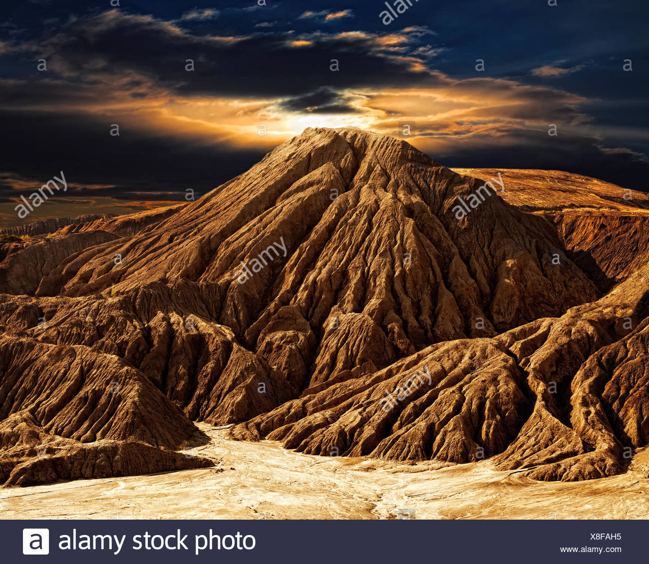 Fantastic desert mountain landscape with the night sky - Stock Image