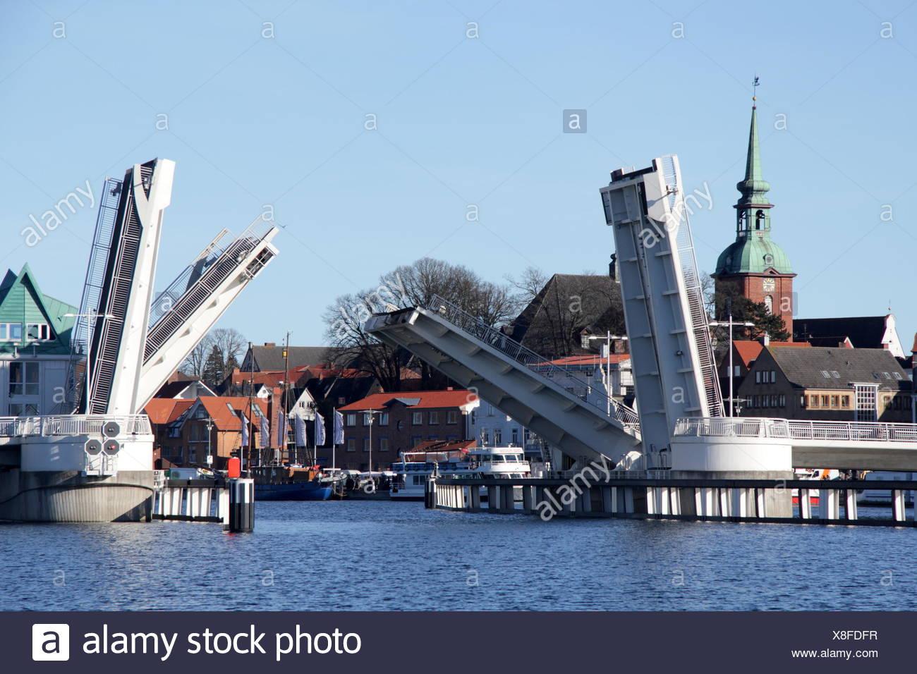 opening flap bridge in Kappeln from waterside - Stock Image