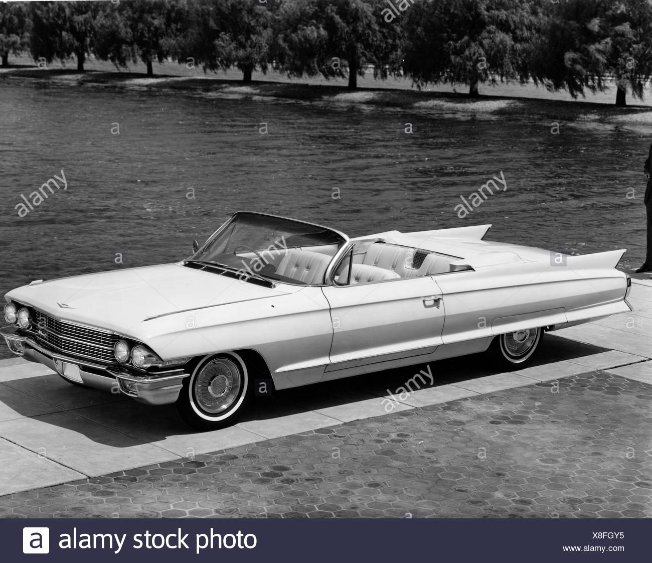 High angle view of a convertible car parked near lake, 1962 Cadillac Series 62 - Stock Image
