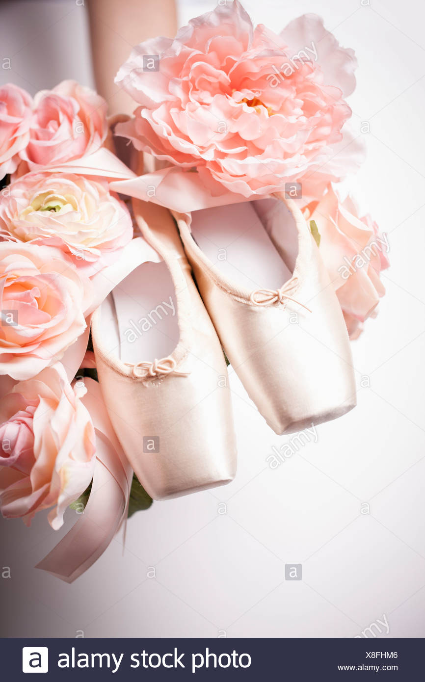 3c3264343dd a woman holding ballet shoes on flowers Stock Photo  280626310 - Alamy