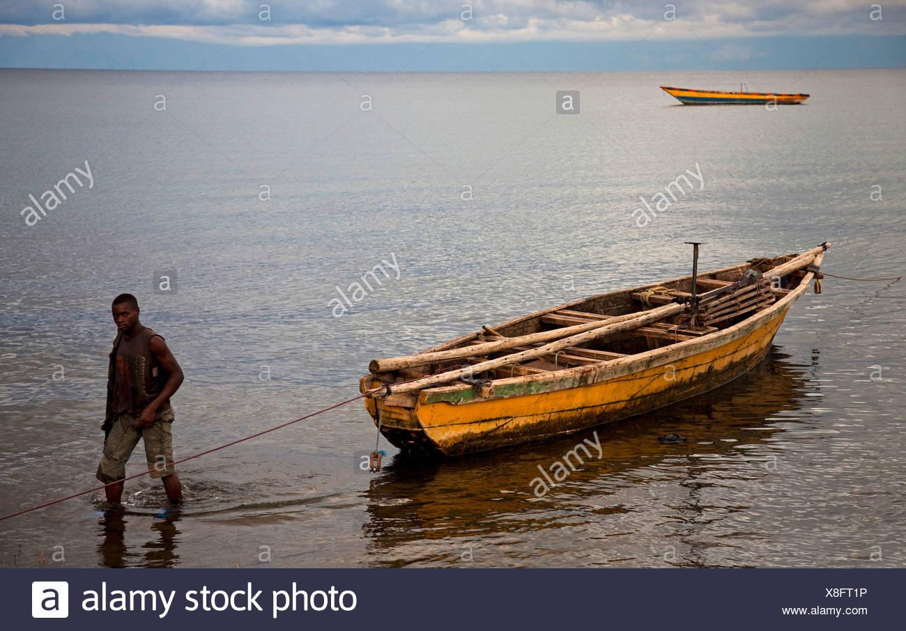 fisherman with fishing boat at Lake Tanganyika, Burundi, Makamba - Stock Image