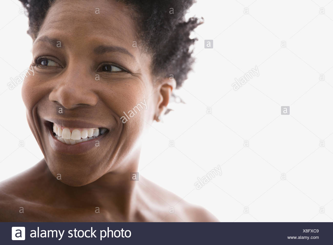 Close up of smiling woman looking away - Stock Image